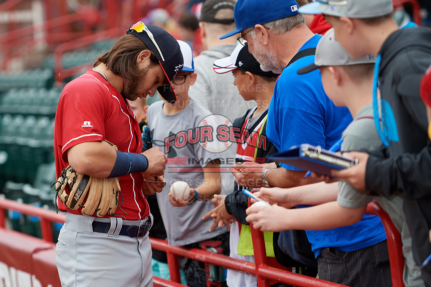 New Hampshire Fisher Cats Bo Bichette (5) signs autographs for fans before a game against the Erie SeaWolves on June 20, 2018 at UPMC Park in Erie, Pennsylvania.  New Hampshire defeated Erie 10-9.  (Mike Janes/Four Seam Images)