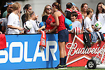 09 November 2013: Forward Alex Morgan signs autographs. The United States Women's National Team held a Training Session at the Citrus Bowl in Orlando, Florida