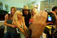 Jennifer Aniston, Paris Hilton, Johnny Depp and Jessica Simpson impersonators pose for tourists at The Sunburst Convention of Tribute Artists