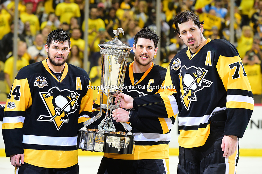 May 25, 2017: Pittsburgh Penguins left wing Chris Kunitz (14), captain Sidney Crosby (87) and center Evgeni Malkin (71) pose with the Prince of Wales trophy after winning game seven of the National Hockey League Eastern Conference Finals between the Ottawa Senators and the Pittsburgh Penguins, held at PPG Paints Arena, in Pittsburgh, PA. The Pittsburgh Penguins defeat the Ottawa Senators 3-2 in double overtime to win the NHL Eastern Conference Championship and advance to face the Nashville Predators in the Stanley Cup Finals.  Eric Canha/CSM