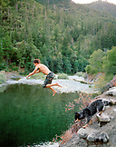 USA, California, young man jumping into the Salmon River, Forks of Salmon, Otter Bar Kayaking School