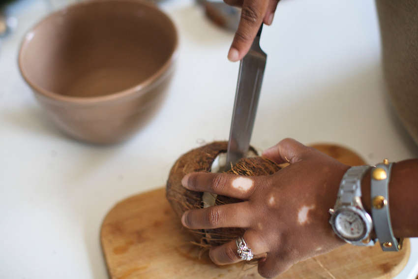 Brooklyn, NY - June 1, 2016: Cookbook author Nicole Taylor demonstrates how to make fresh coconut milk.<br /> <br /> CREDIT: Clay Williams for SheKnows.<br /> <br /> &copy; Clay Williams / claywilliamsphoto.com