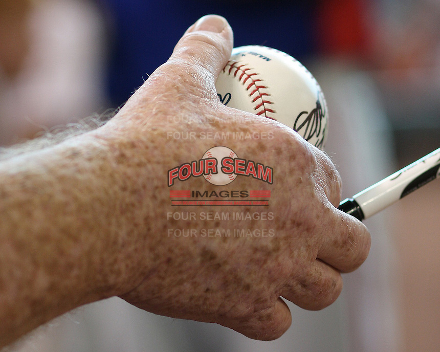 Fan with autographed ball. Photo by Andrew Woolley / Four Seam Images.