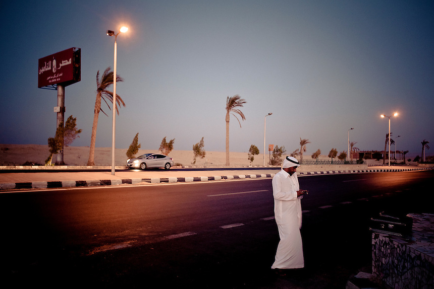 A bedouin man stands by a highway in the Sinai peninsula, Egypt, September 2011. Photo: Ed Giles.