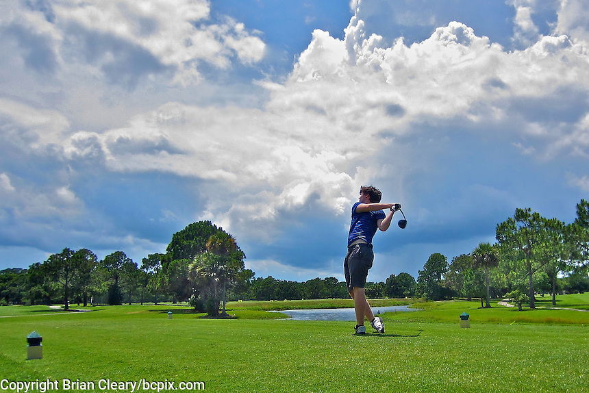 A golfer hits a drive on the third tee, Riviera Country Club, Ormond Beach, FL, June 2014.  (Photo by Brian Cleary/www.bcpix.com)