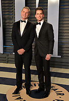 BEVERLY HILLS, CA - MARCH 4: Simon Halls and Matt Bomer arrive at the 2018 Vanity Fair Oscar Party at the Wallis Annenberg Center for the Performing Arts on March 4, 2018 in Beverly Hills, California.(Photo by Scott Kirkland/PictureGroup)