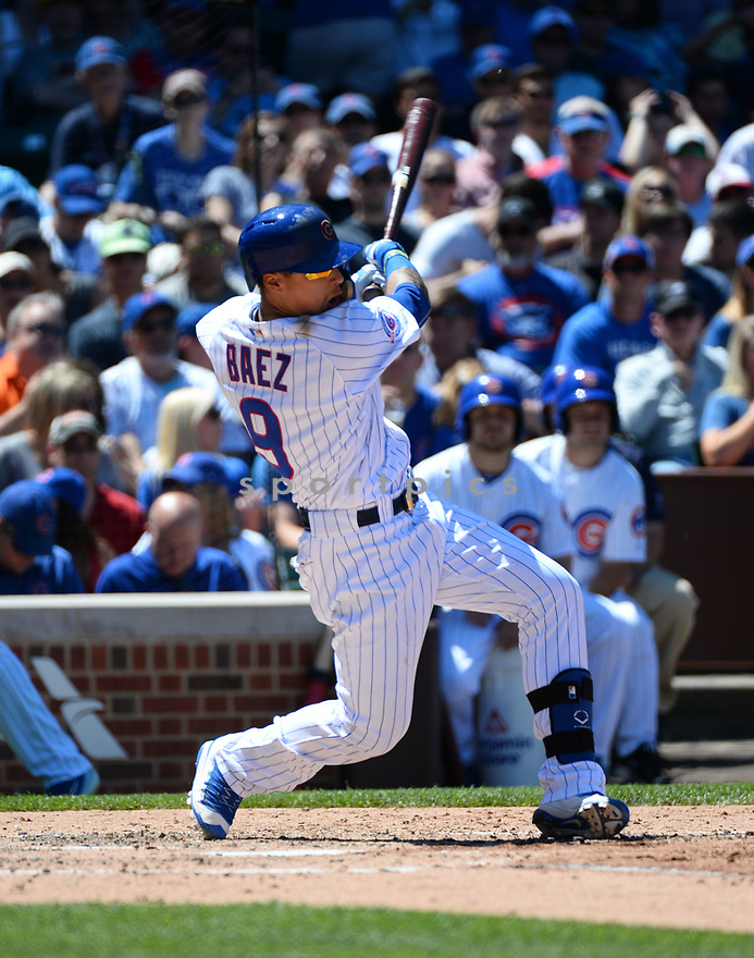 Chicago Cubs Javier Baez (9) during a game against the Pittsburgh Pirates on June 17, 2016 at Wrigley Field in Chicago, IL. The Cubs beat the Pirates 6-0.