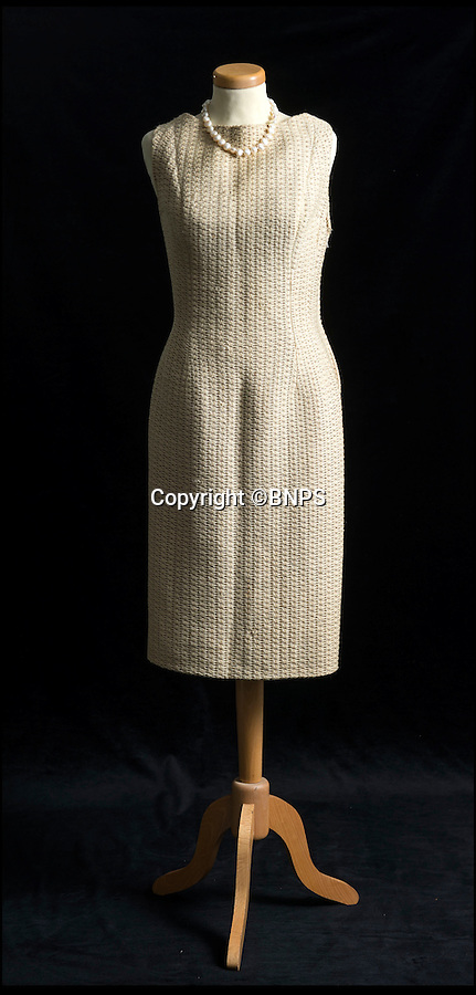 BNPS.co.uk (01202 558833)<br /> Pic: PhilYeomans/BNPS<br /> <br /> This Balmain dress was also worn by Loren in the movie,  and is also in the sale.<br /> <br /> Dressed to thrill - the stunning dress that led to Peter Sellers infatuation with screen goddess Sophia Loren is coming up for auction - but you may have to actually be a Miliionairess to afford it.<br /> <br /> Sophia Loren stripped off the salmon pink Balmain gown in a racy scene from the 1960 blockbuster 'The Millionairess' and unlikely leading man Peter Sellers was so entranced by the beautiful young italian star that he offered to leave his new wife for her.<br /> <br /> Dukes auctioneers in Dorchester are now selling the dress along with two others from the film and haute couture expert Antoinette Rogers says it could go for up to £10,000 thanks to its unique and glamorous provenance.