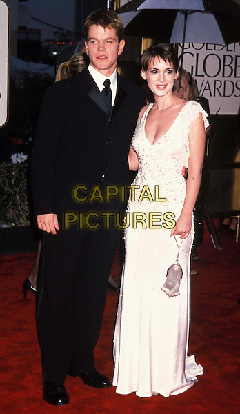 MATT DAMON & WINONA RYDER.Golden Globe Awards.Ref: 9610.black suit, ex celebrity couple, white dress, plunging neckline,red carpet, full length, full-length.www.capitalpictures.com.sales@capitalpictures.com.©Capital Pictures.