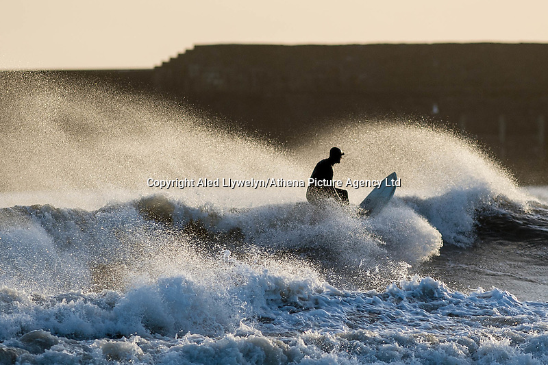Thursday 23 February 2017<br /> Pictured: A surfer takes advantage of the huge waves in front of the harbour wall at Porthcawl, Wales, UK<br /> Re: Storm Dorris batters the UK