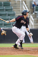 Brett Austin (10) of the Kannapolis Intimidators follows through on his swing against the Charleston RiverDogs at CMC-NorthEast Stadium on June 27, 2014 in Kannapolis, North Carolina.  The Intimidators defeated the RiverDogs 6-5.  (Brian Westerholt/Four Seam Images)