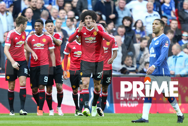 Marouane Fellaini of Manchester United (2nd right) celebrates scoring the opening goal against Everton during the FA Cup Semi-Final match between Everton and Manchester United at Wembley Stadium, London, England on 23 April 2016. Photo by David Horn / PRiME Media Images.