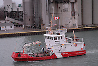Canadian Coast Guard buoy tender Gull Isle sails past Cargill AGHorizons grain terminal at the Government Docks, Sarnia heading  to the St. Clair River.