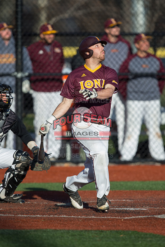Seth Hoagland (1) of the Iona Gaels follows through on his swing against the Rutgers Scarlet Knights at City Park on March 8, 2017 in New Rochelle, New York.  The Scarlet Knights defeated the Gaels 12-3.  (Brian Westerholt/Four Seam Images)