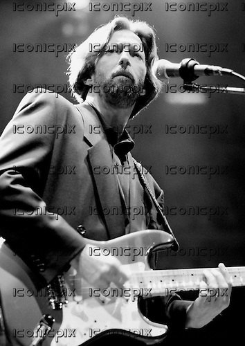 Eric Clapton - performing live in concert at the Royal Albert Hall in  London UK - 31 Jan 1990.  Photo credit: George Chin/IconicPix