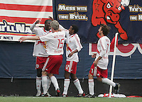 New York Red Bulls' Jozy Altidore, left, is congratulated by teammates John Wolyniec (15), Danleigh Borman (12) and Mike Magee (7) after Altidore scored in the final minutes against the San Jose Earthquakes in an MLS soccer match at Giants Stadium in East Rutherford, N.J. on Sunday, April 27, 2008. The Red Bulls defeated the Earthquakes 2-0.
