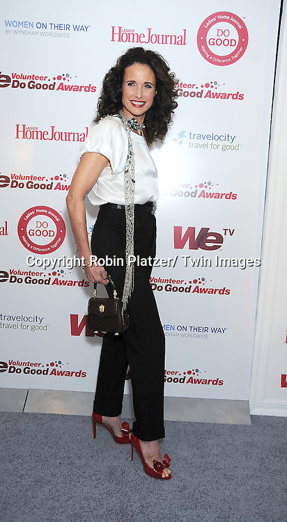 Andie MacDowell posing for photographers at the We tv and Ladies' Home Journal's first annual WE Do Good Awards, which honors every day women who make a positive impact through volunteerism, on November 16, 2010 .at Espace in New York City.