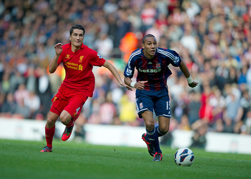 Stoke City's Steven N'Zonzi gets away from Liverpool's Nuri Sahin ..Football - Barclays Premiership - Liverpool v Stoke City - Sunday 7th October 2012 - Anfield - Liverpool..