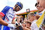 Thibaut Pinot (FRA) Groupama-FDJ with young fans at sign on before Stage 7 of the Criterium du Dauphine 2019, running 133.5km from Saint-Genix-les-Villages to Les Sept Laux - Pipay, France. 15th June 2019.<br /> Picture: ASO/Alex Broadway | Cyclefile<br /> All photos usage must carry mandatory copyright credit (© Cyclefile | ASO/Alex Broadway)