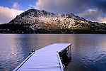 Snow covered dock and Mount Tallac, Fallen Leaf Lake in winter, near Lake Tahoe, California