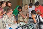 British herpetologist Mark O'Shea, holding a dog-faced water snake, Cerberus rynchops, speaks to American and Timorese students at their makeshift research station at Bakhita Mission, Near Eraulo, Ermera District, Timor-Leste (East Timor). Left to right: Caitlin Sanchez, Scott Heacox, Professor Hinrich Kaiser, Luis Lemos, Mark O'Shea, Benny Carvalho, Zito Afranio, Marianna Tucci.