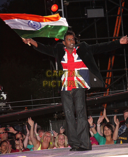 SREE DASARI .Big Brother Series 10 Launch Night at Elstree Studios, Borehamwood, Herts, England, UK, June 4th 2009.full length new housemates housemate flag union jack shirt jeans black jacket blazer waving Indian flag.CAP/ROS.©Steve Ross/Capital Pictures