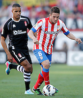 Atletico de Madrid's Koke (r) and Granada's Youssef El Arabi during La Liga match.April 14,2013. (ALTERPHOTOS/Acero)