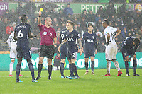 Davinson Sanchez of Tottenham Hotspur receives a yellow card from Referee Bobby Madley during the Premier League match between Swansea City and Tottenham Hotspur at the Liberty Stadium, Swansea, Wales, UK. Tuesday 02 January 2018
