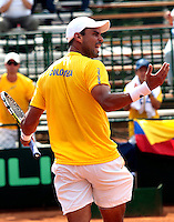 CALI - COLOMBIA - 03-04-2014: Alejandro Falla de Colombia celebra el punto durante partido de la serie final de partidos en el Grupo I de la Zona Americana de la Copa Davis, partidos entre Colombia y República Dominicana en Estadio de Tenis Alvaro Carlos Jordan en la ciudad de Cali. / Alejandro Falla of Colombia celebrates the point during a match to the final series of matches in Group I of the American Zone Davis Cup, match between Colombia and Dominican Republic at the Alvaro Carlos Jordan Tennis Stadium in Cali, city. Photo: VizzorImage / Juan C Quintero / Str