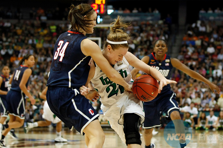 01 APRIL 2012:  Kelly Faris (34) of the University of Connecticut pressures Natalie Novosel (21) of the University of Notre Dame during the Division I Women's Final Four Semifinals at the Pepsi Center in Denver, CO.  Notre Dame defeated UCONN 83-75 to advance to the national championship game.  Jamie Schwaberow/NCAA Photos