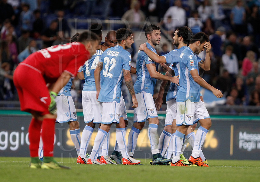 Calcio, Serie A: Lazio vs Frosinone. Roma, stadio Olimpico, 4 ottobre 2015.<br /> Lazio&rsquo;s Filip Djordjevic, third from right, celebrates with teammates after scoring during the Italian Serie A football match between Lazio and Frosinone at Rome's Olympic stadium, 4 October 2015.<br /> UPDATE IMAGES PRESS/Isabella Bonotto