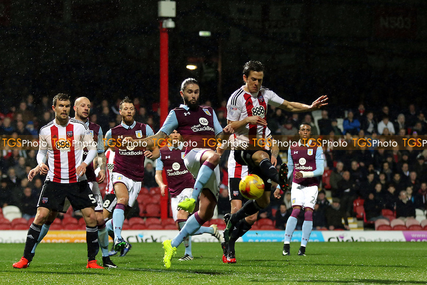 Henri Lansbury of Aston Villa and Brentford's Lasse Vibe challenge for the ball during Brentford vs Aston Villa, Sky Bet EFL Championship Football at Griffin Park on 31st January 2017