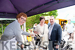 Patricia Riordan of Glenbeigh Shellfish serving Kevin and Kay Griffin at the Glenbeigh Summer Market on Sunday.