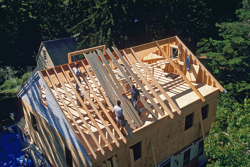 Overview of the framed roof of a second floor addition to a house under contruction.