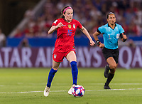 LYON,  - JULY 2: Rose Lavelle #16 dribbles during a game between England and USWNT at Stade de Lyon on July 2, 2019 in Lyon, France.