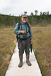 Gary Lee, a retired Forest Ranger, was our local guide in the Adirondacks. He is standing on a hard plastic walk way laid over Ferd's Bog a dense matt of sedge grass over water.