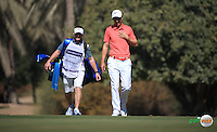 Ross Fisher (ENG) and caddie Mark head up the 3rd during the Final Round of the 2016 Omega Dubai Desert Classic, played on the Emirates Golf Club, Dubai, United Arab Emirates.  07/02/2016. Picture: Golffile | David Lloyd<br /> <br /> All photos usage must carry mandatory copyright credit (&copy; Golffile | David Lloyd)
