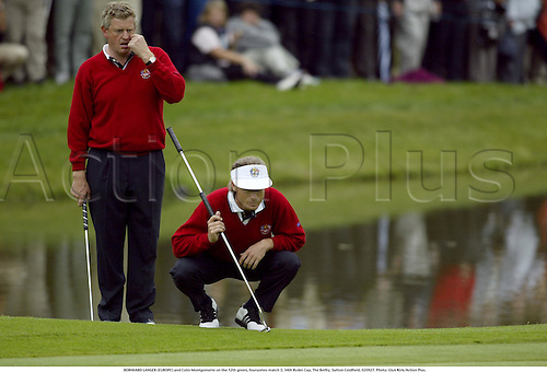 BERNHARD LANGER (EUROPE) and Colin Montgomerie on the 12th green, foursomes match 3, 34th Ryder Cup, The Belfry, Sutton Coldfield, 020927. Photo: Glyn Kirk/Action Plus....Golf golfer player 2002..................................