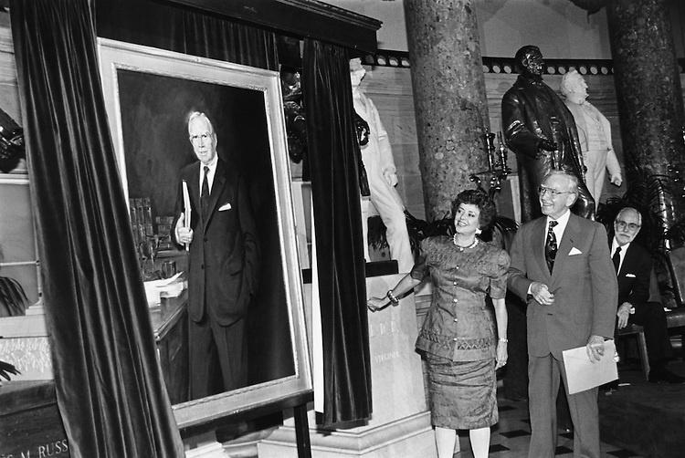Unveiling of Rep. Jim Wright, D-Texas, portrait by his wife, Betty. Here she is with Jim and Marshall Bouldin and the artist is in the background. The ceremony took place in Statuary Hall. October 1991 (Photo by Maureen Keating/CQ Roll Call)