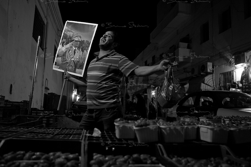 Tripoli, Libya, March 12, 2011.An eerie calm reigns in the medina, the ancient city center. Signs of support for the Khaddafi regime are everywhere to be seen, and 'sponaneous' expressions of support appear as soon as a foregn journalist appears.