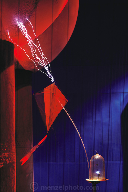 Franklin's lightning experiment. Model demonstrating the idea of the experiment conducted by Benjamin Franklin in 1750 on the nature of lightning. Franklin (1706-1790) was an American experimenter in static electricity. He wanted to show that lightning was a form of static electricity and could be drawn from the cloud by means of a tall metal spike. Delays to construction led him to try using a kite instead, and he indeed found that he could charge a capacitor by lightning drawn along a wet cord from the kite. Many later scientists died trying to duplicate the experiment. This model is in the Boston Museum of Science, USA. 1991.