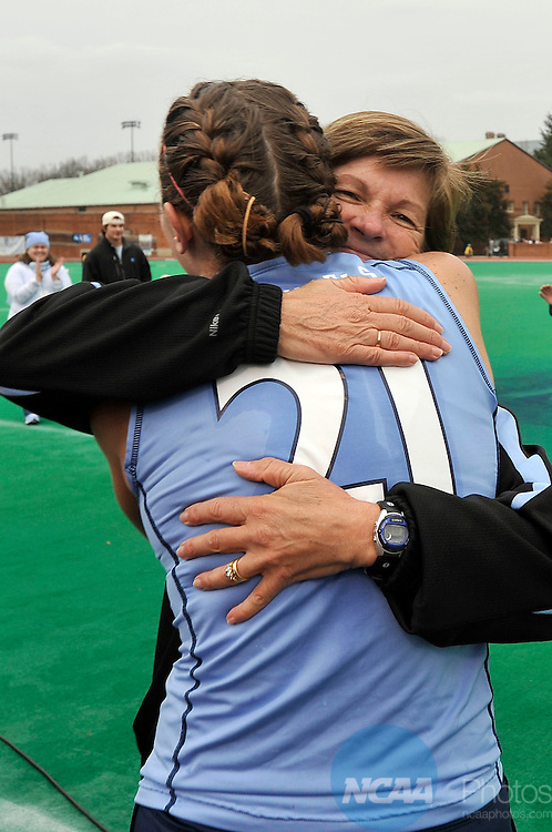 22 NOV 2009: Coach Karen Shelton celebrates with Meghan Dawson (21) of the University of North Carolina after defeating the University of Maryland during the Division I Women's Field Hockey Championship held at Kentner Stadium on the Wake Forest University campus in Winston-Salem, NC.  North Carolina defeated Maryland 3-2 for the national title.  Grant Halverson/NCAA Photos