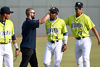 Strength and conditioning coach Sam Nickelsen of the Columbia Fireflies works with his team before a game against the Charleston RiverDogs on Saturday, April 6, 2019, at Segra Park in Columbia, South Carolina. Columbia won, 3-2. (Tom Priddy/Four Seam Images)