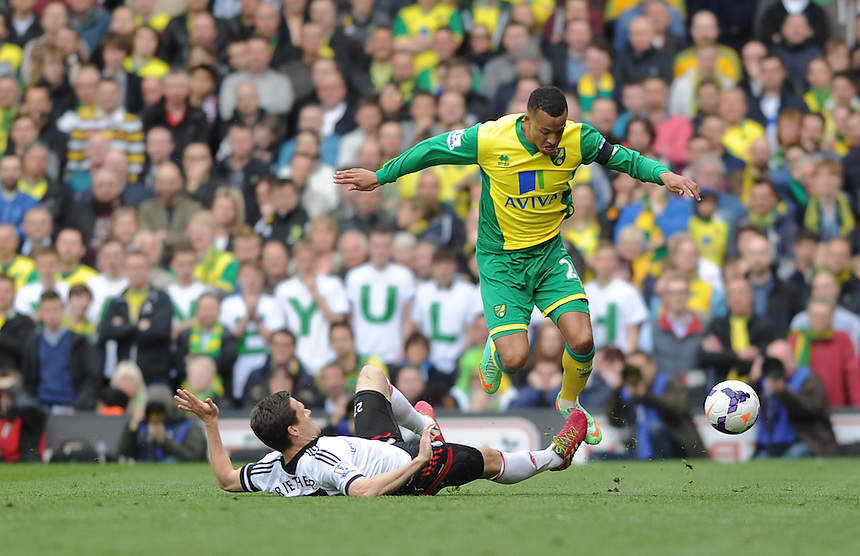 Norwich City's Martin Olsson is tackled by Fulham's Sascha Riether<br /> <br /> Photo by Ashley Western/CameraSport<br /> <br /> Football - Barclays Premiership - Fulham v Norwich City - Saturday 12th April 2014 - Craven Cottage - London<br /> <br /> &copy; CameraSport - 43 Linden Ave. Countesthorpe. Leicester. England. LE8 5PG - Tel: +44 (0) 116 277 4147 - admin@camerasport.com - www.camerasport.com