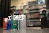 JD Cigarettes are sold at Penny Saver Food and Gas, 2715 S Elm-Eugen Street, Greensboro, NC on Monday, July 11, 2016. (Justin Cook for The Wall Street Journal)<br /> <br /> TOBACCO<br /> <br /> Story Summary: Japan Tobacco Inc. is quietly invading U.S. tobacco country with a new discount cigarette brand. At Penny Saver Food and Gas near downtown Greensboro, N.C., the company&rsquo;s LD cigarettes have prime placement, around eye level in the middle of the section, allowing them to stand out alongside established brands like Marlboro, Newport and Camel. Its $2.81 price tag compares favorably with Marlboro at $5.25 and puts it in position to challenge discount brands L&amp;M at $3.69 and Pall Mall at $3.73. The red, blue, green and silver packs of cigarettes with the LD logo stamped on the right corner are part of a plan to give the world&rsquo;s second-largest tobacco company a toehold in the lucrative U.S. market. Almost all of Japan Tobacco&rsquo;s roughly $21 billion in sales comes from outside the U.S. LD is the first global brand the company introduced in the U.S. in March. The company said it is testing the discount cigarette&rsquo;s appeal in North Carolina and South Carolina and will launch the brand nationwide depending on its performance as early as next year with 10 style variations. Japan Tobacco&rsquo;s investment in LD is part of an about face for Big Tobacco. After years of spurning the U.S. because of mounting civil suits, international tobacco companies are returning as the country becomes more attractive than international markets. Legal risks here are fading and prices are rising. Plus, thanks to the First Amendment, companies here are protected from having to use plain packaging or apply graphic warning labels that show images of gangrene feet, rules currently gaining momentum worldwide. The Tokyo-based company has increased its staff in the U.S. by 20% over the past five years to 147 employees and invested heavily in the U.S. e-cigarette company 