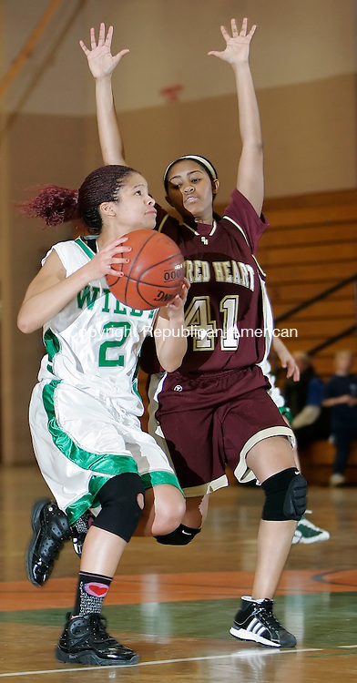 WATERBURY, CT, 12/16/08- 121608BZ13-  Wilby's Mariah Petty (2) goes to the hoop against Sacred Heart's Jy Dea Flowers (41) during their game at Wilby Tuesday night. <br /> Jamison C. Bazinet Republican-American