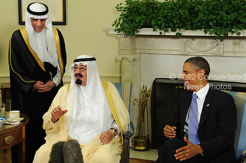 United States President Barack Obama and King Abdullah of Saudi Arabia share a laugh as they speak to the media after their meeting in the Oval Office of the White House in Washington on June 29, 2010.   .Credit: Roger L. Wollenberg - Pool via CNP