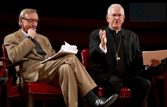 Sept. 4, 2012;  The Most Reverend Joseph E. Kurt, D.D., answers a question during the kick-off event for the 2012-13 Notre Dame Forum: Conviction vs. Compromise: Being a Person of Faith in a Liberal Democracy at the DeBartolo Performing Arts Center. Listening on the left is panelist Rev. Richard Cizik, president of the New Evangelical Partnership for the Common Good. Photo by Barbara Johnston/University of Notre Dame
