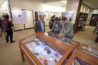 Physics professor Daniel Snowden-Ifft looks at the Cosman Shell Collection display in the Academic Commons. After researching all summer, Occidental College students present their work at the annual Summer Undergraduate Research Conference on July 29, 2015.<br /> (Photo by Marc Campos, Occidental College Photographer)