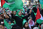 Palestinian Hamas supporters attend a rally marking the 32th anniversary of the founding of the Hamas movement, in Gaza city, December 14, 2019. Photo by Ashraf Amra
